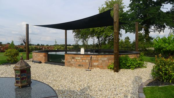 Contemporary pond construction wishaw landscapes for Carp pond design