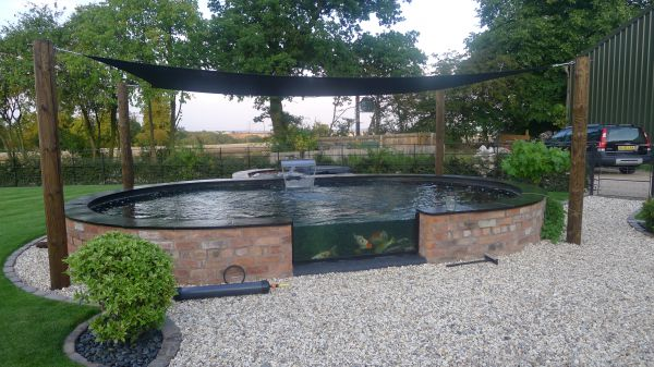 Contemporary pond construction wishaw landscapes for Koi pond shade ideas